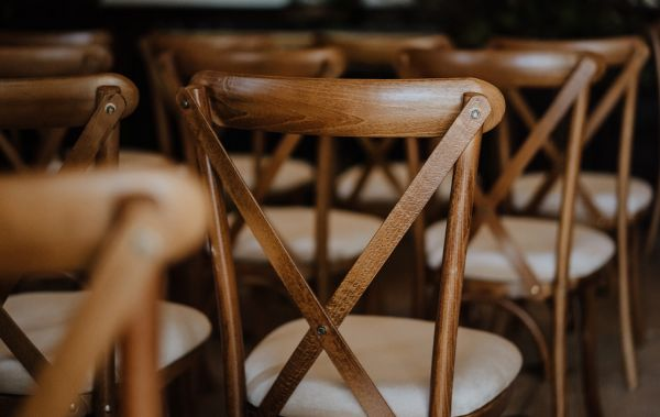 cross back chairs to accompnay rustic trestle tables from Crystal Hire